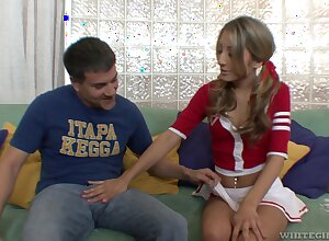 Cute pigtailed cheerleader Natalia Rossi gives a blowjob plus rides load of shit