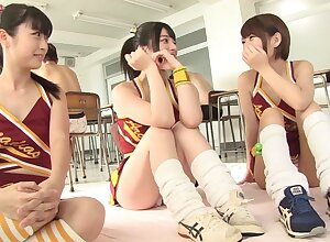 Close up video of 3 dudes going to bed team a few Japanese cheerleaders